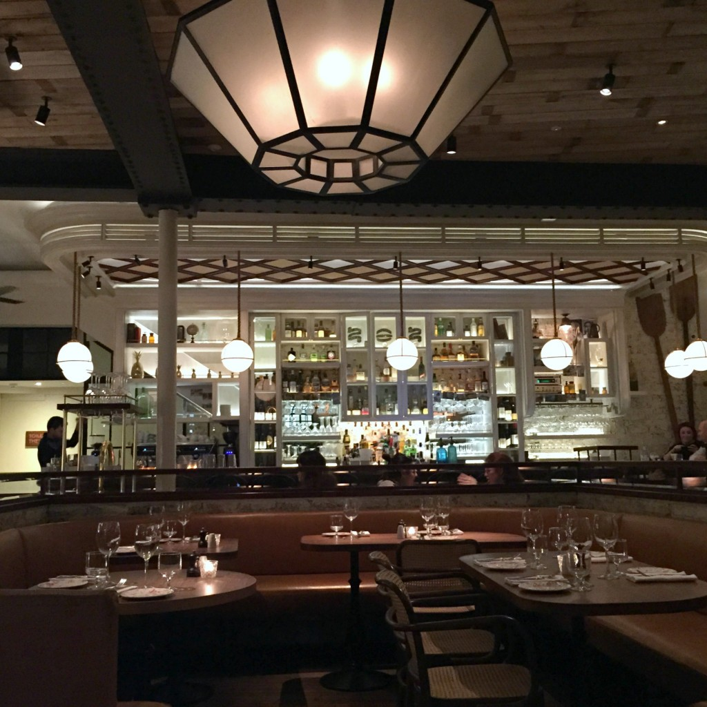 The grand restaurant area of Blixen with backlit bar, Old Spitalfields Market.