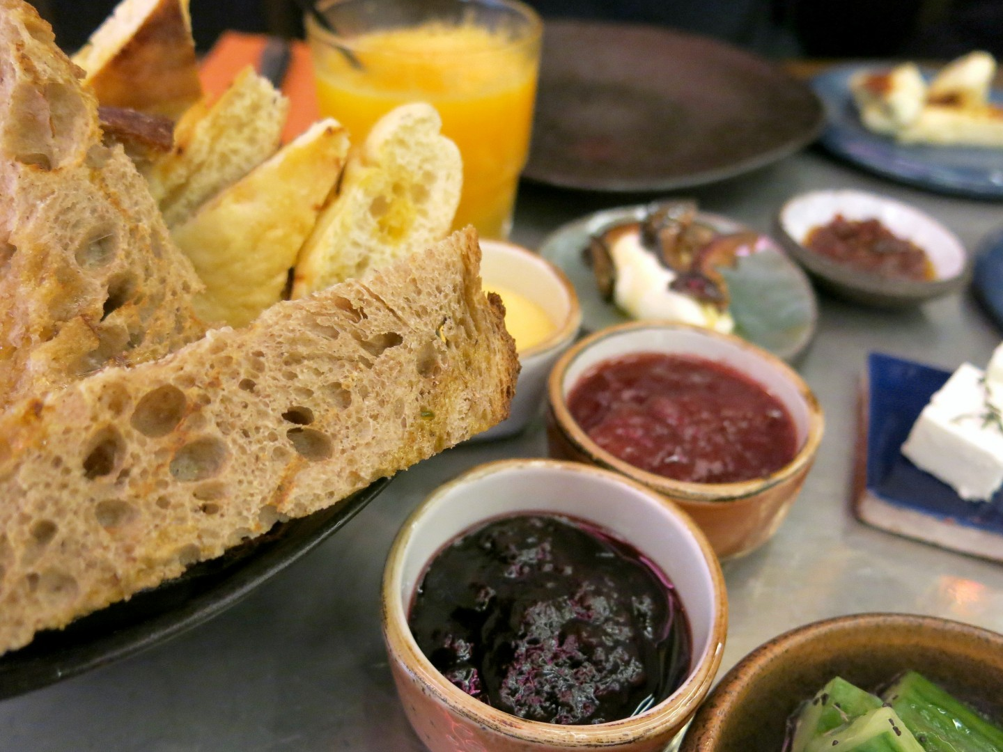 The homemade jams and warm bread part of the breakfast meze at Firedog, just moments from Oxford Street.