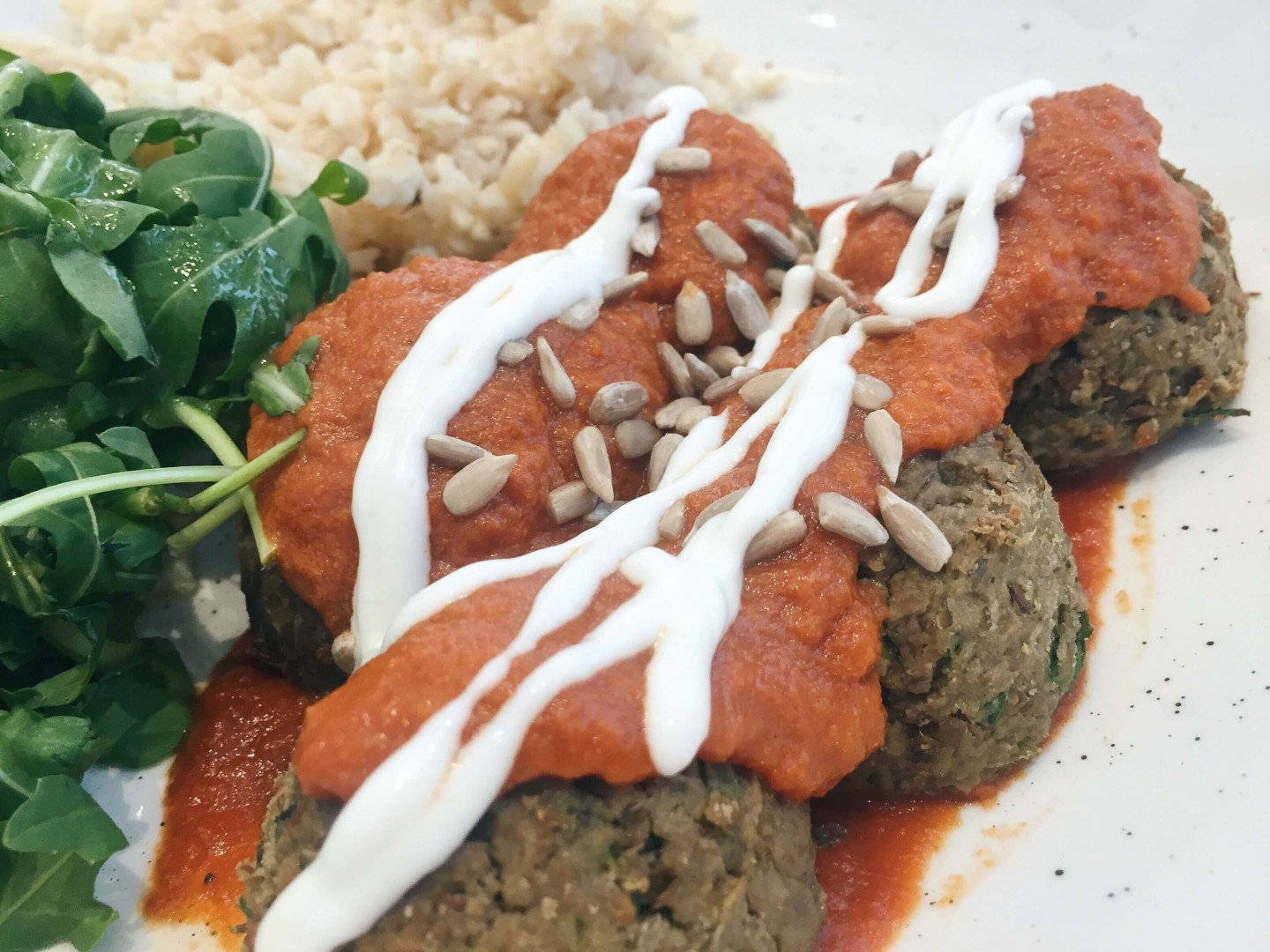 The lentil and onion balls with cashew cream are vegan and utterly delicious! I loved The Mae Deli!