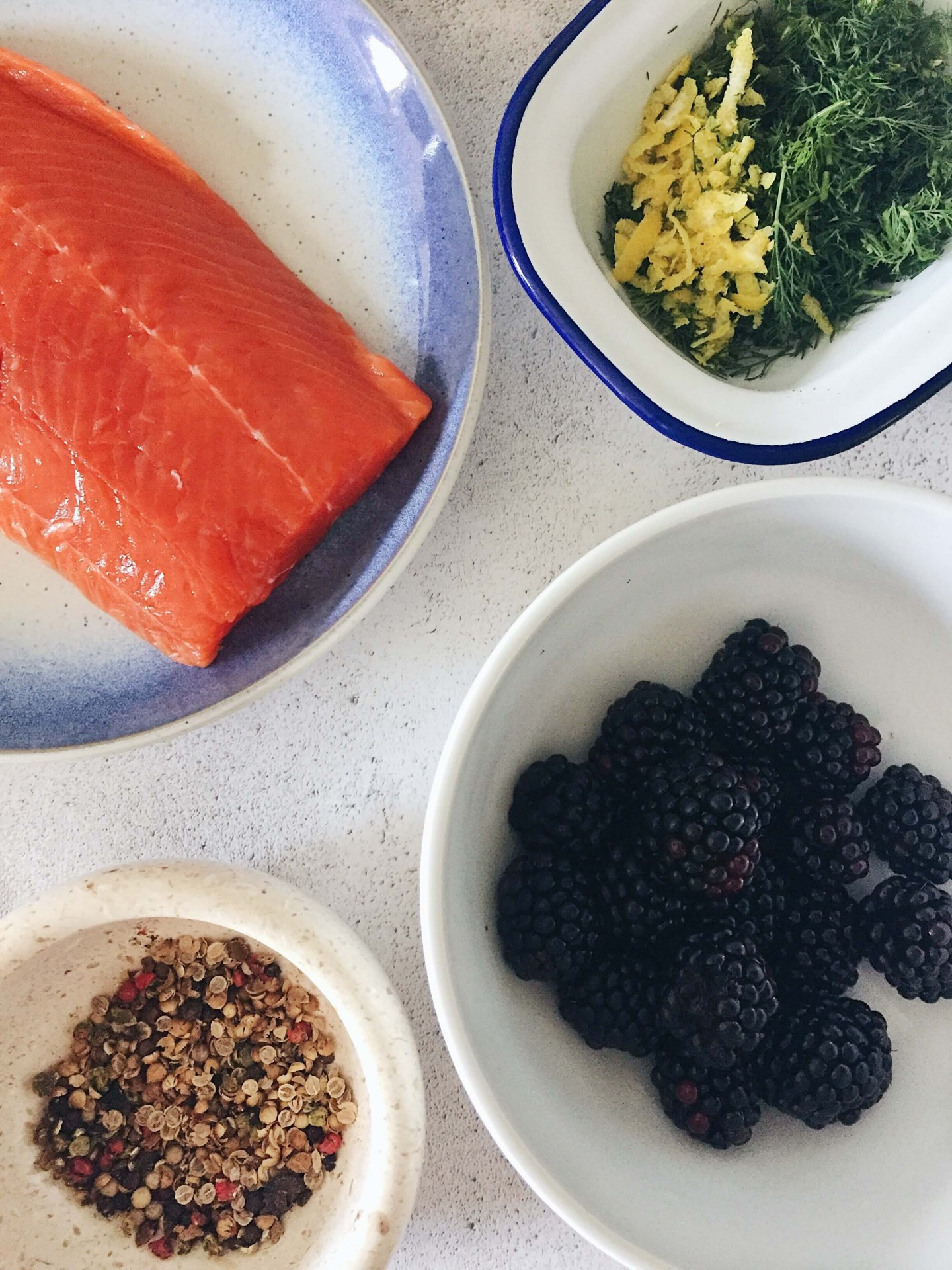 The ingredients for gin and blackberry cured salmon recipe.