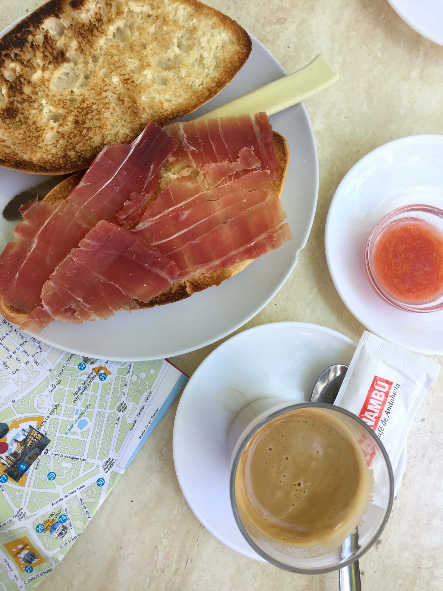 When you visit Seville in Spain, make sure you eat breakfast like a local! Pan con tomate with jamon is a must try. Find out other Top things to see and do in Seville.