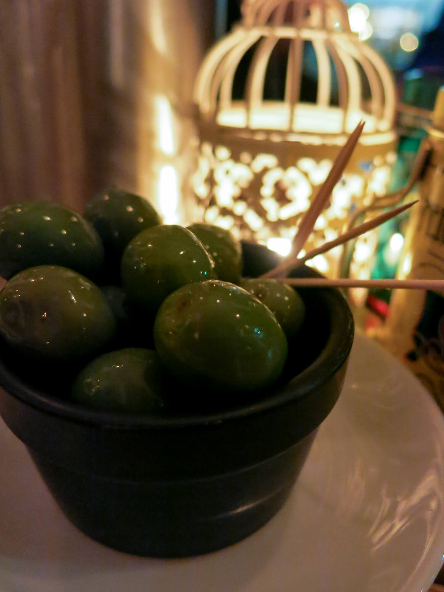 Juicy green olives at Meridionale in Fulham, London. Great pizza and interesting pasta menu.