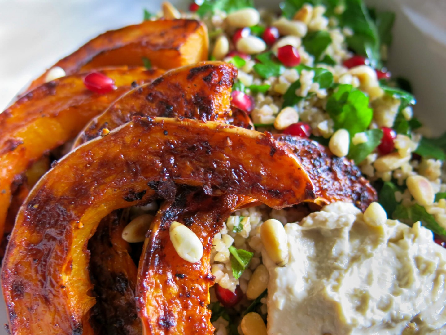 A quick and easy vegetarian salad recipe. Includes butternut squash, bulgar wheat, harrisa, pomegranate and pine nuts.