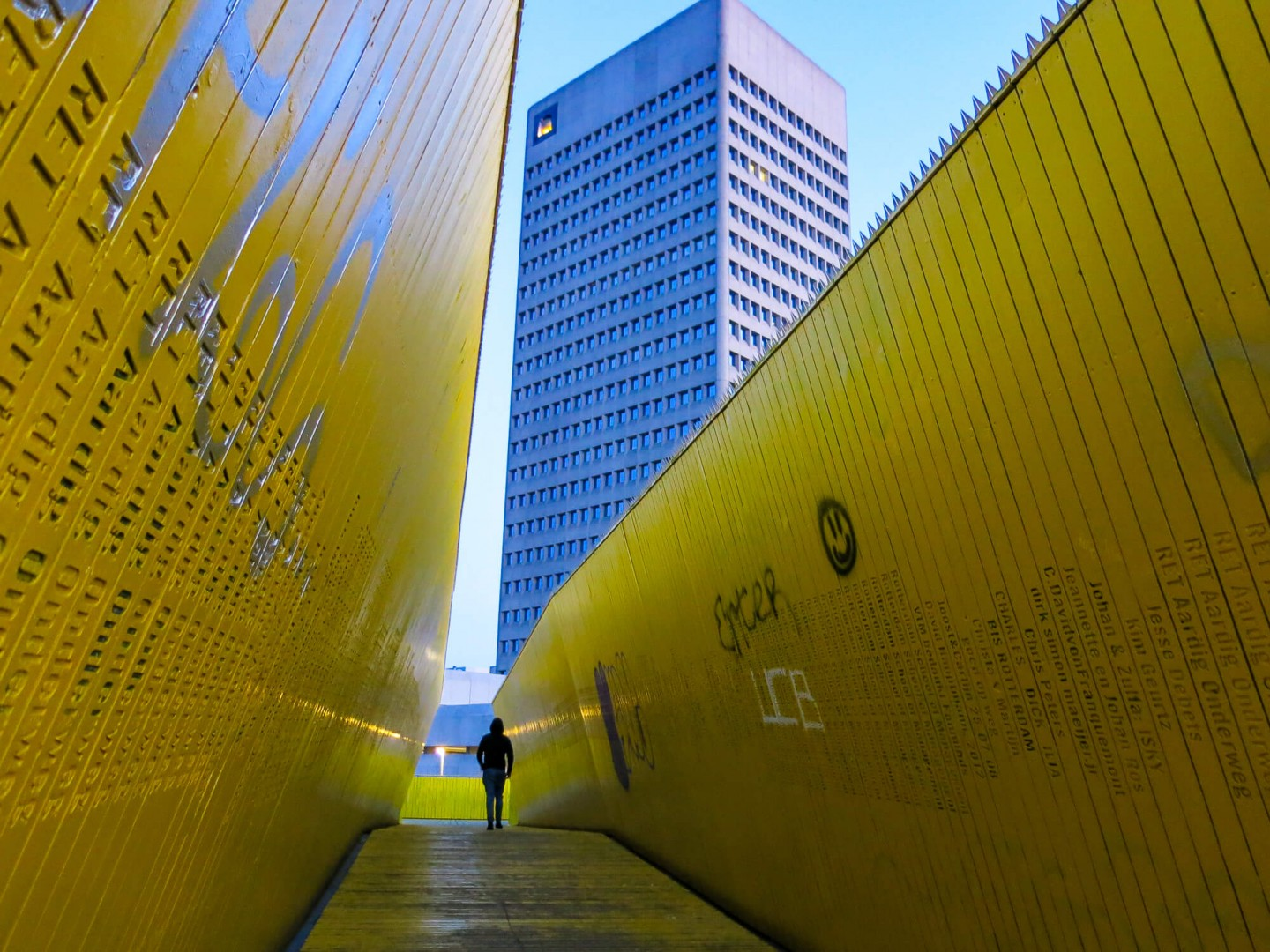 The Luchtsingel bridge in Rotterdam. The bright yellow wooden structure is a pedestrian pathway that connects Rotterdam Centraal station with the historic Laurenskwartier district.