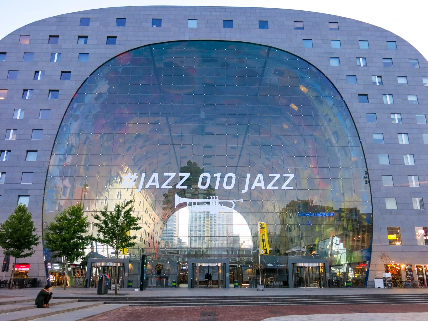 The Markthal in Rotterdam is a massive market hall with food stalls, restaurants and a supermarket. It also has apartments that have windows down into the market. It's a wonderful building!