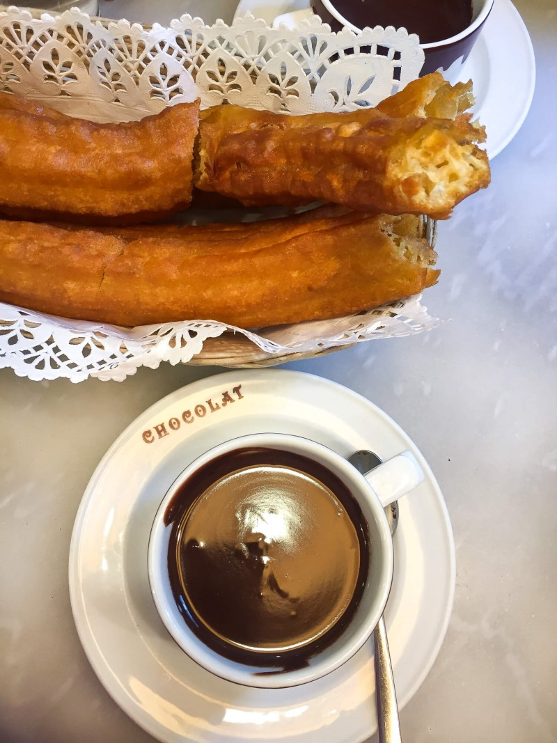 Porras with hot chocolate for breakfast in Madrid. These are large churros and so delicious! This three day guide to Madrid includes where to eat in Madrid.