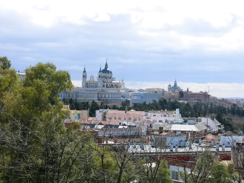 The view out from Parque del Oeste over the Royal Palace in Madrid. My three day guide can help you to plan what to do when in Madrid.