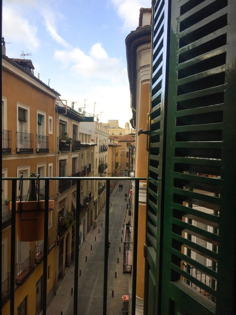 View from our balcony in our apartment in Lavapies in Madrid Spain. Three day guide sharing the top things to do in Madrid and where to eat. 3 day itinerary.