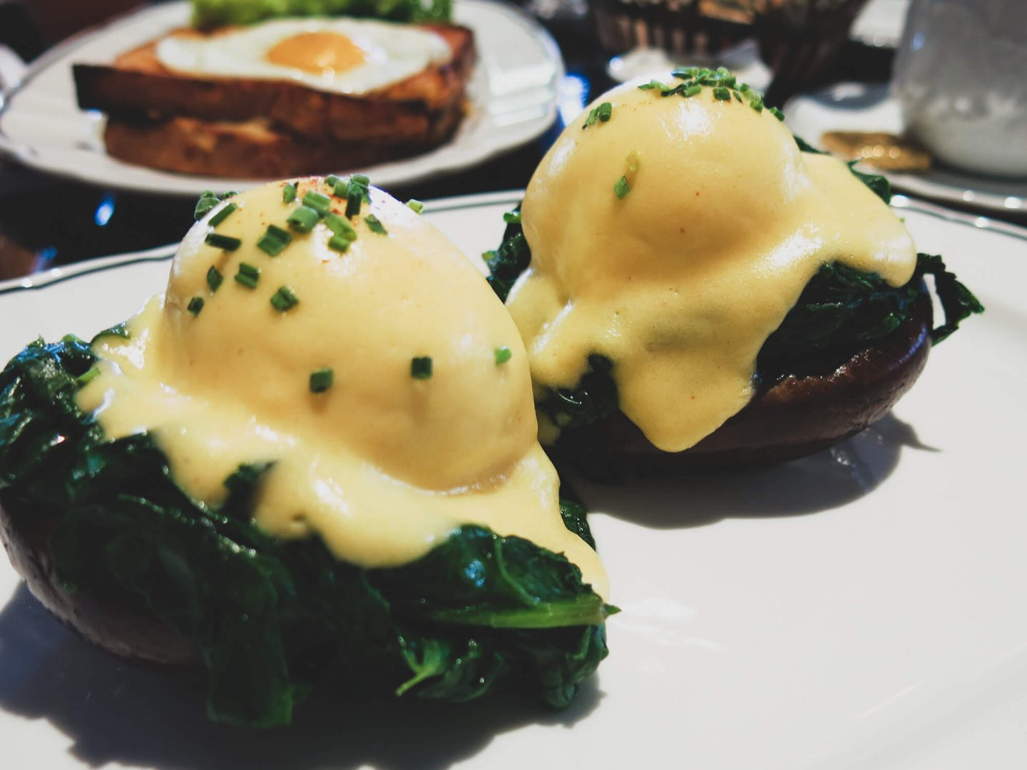 Eggs Portobello at Bellanger. Portobello mushrooms topped with spinach, poached eggs and hollandaise sauce. Great restaurant for brunch in London.