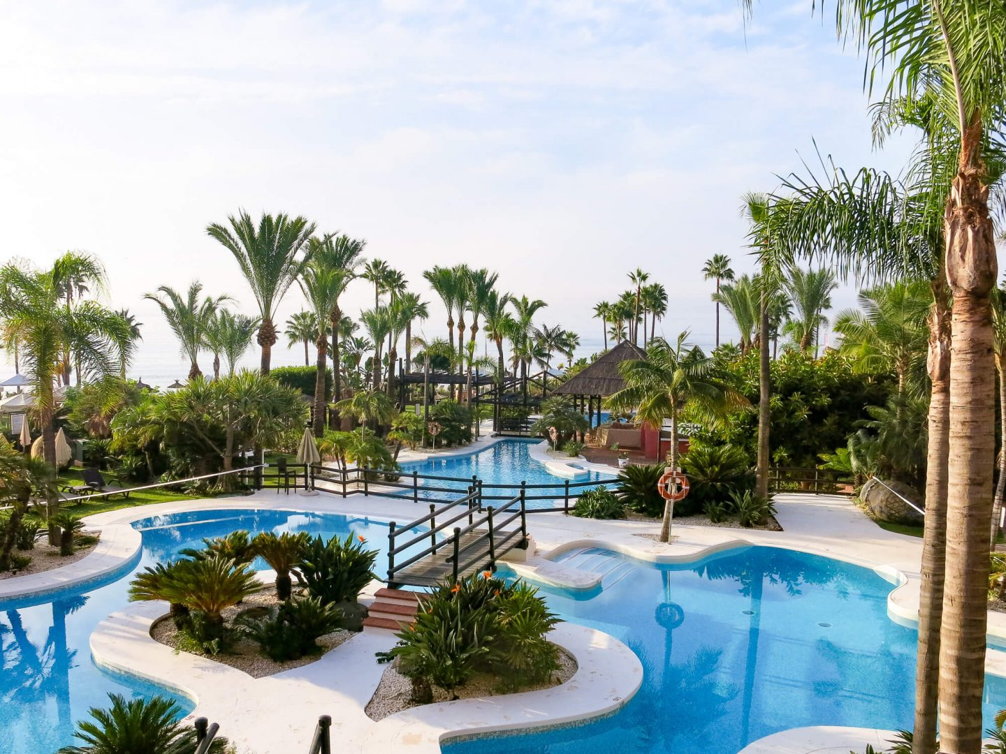 The swimming pool and gardens at Kempinski Hotel Bahía, Spain. 5 star luxury hotel near Marbella.