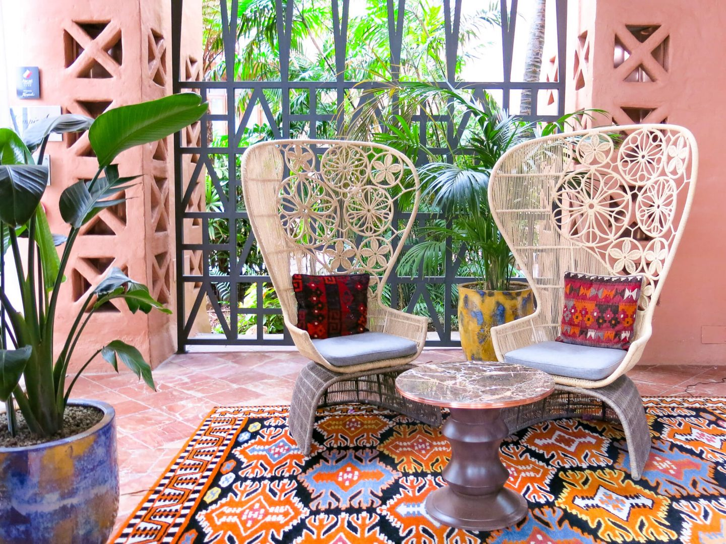 The entrance at Kempinski Hotel Bahía, Spain. Bohemian wicker chairs and rugs. 5 star hotel in Andalusia near Marbella.